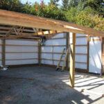 Insulated post-frame building in progress, 3' walk-in door installed
